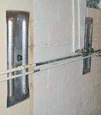 A foundation wall anchor system used to repair a basement wall in Exeter