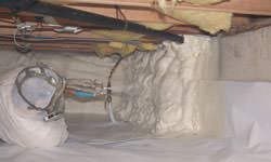 Spray foam insulation in a crawl space in Essex, Ontario