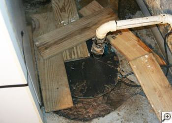 An ugly, clogged sump pump system in Leamington, Ontario