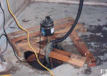 A Listowel sump pump system that failed and lead to a basement flood.