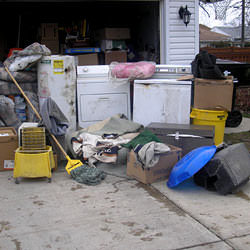Soaked, wet personal items sitting in a driveway, including a washer and dryer in Leamington.