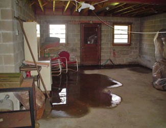 a flooded basement floor in a Lambton Shores home