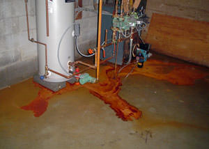 Iron ochre laden water on a concrete basement floor, staining everything in this Mount Forest home.